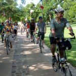 Senator Ellis and participants in the TLIP intern program ride with BikeTexas through the Texas State Cemetery.