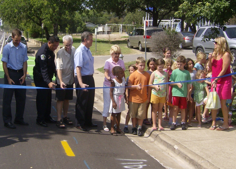 Members of the Zilker community cut the cycletrack ribbon.