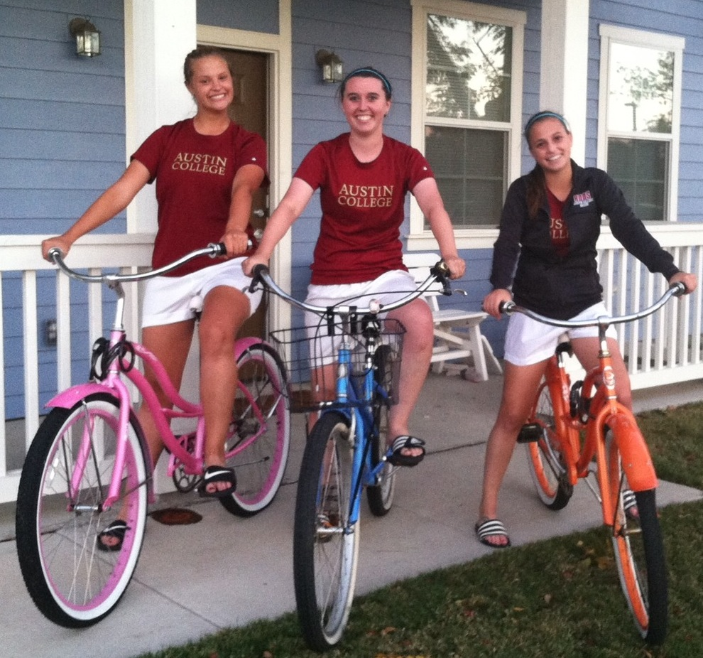 Austin College Soccer Team members like their cruisers