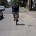 A motorist passes a cyclist safely.