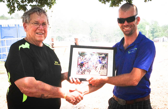 Rick Wetherald accepts a thank-you gift from BikeTexas.
