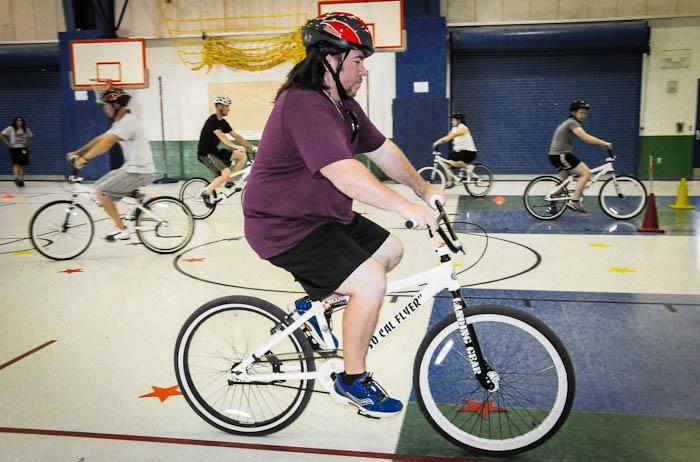 A teacher rides a bike as part of a teacher training.