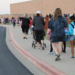 Students make their way to school on Walk to School Day 2012.